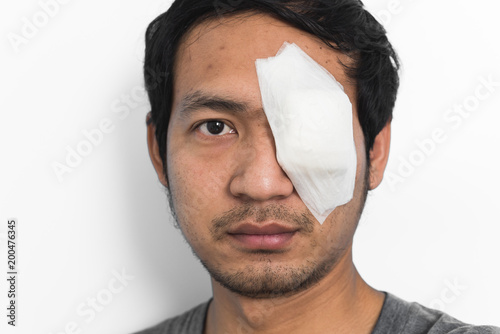 Photo White medicine plaster patch on the eye