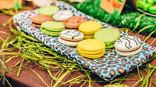 Poster Macarons Macarons in candybar on a decorated tropical party.