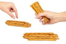 Set Of Salty Cracker Pretzel Sticks, Woman Hands, Isolated On White Background