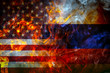 National flags of USA and Russia from a bright flame on a black background