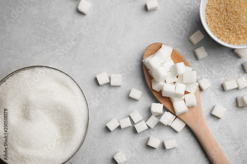Obraz na plátně  Composition with various kinds of sugar on gray background