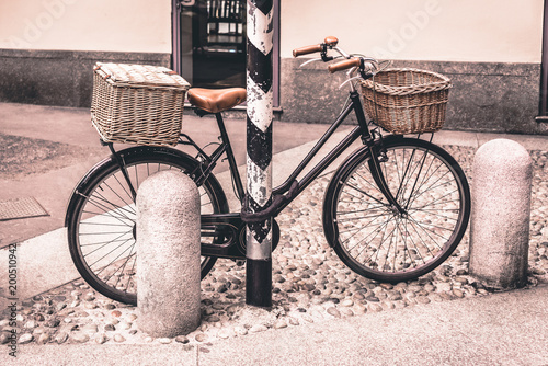 Foto op Canvas Fiets Healthy transport concept. Vintage bicycle left near cafe with old wooden basket in Italy, Milan. Outdoor shot.