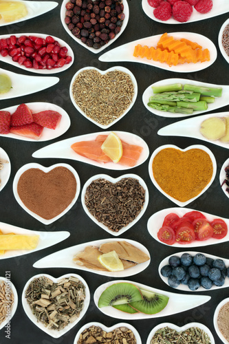 Foto op Aluminium Assortiment Healthy heart food with fish, fruit, vegetables and herbal medicine selection. Super foods high in omega 3 fatty acids, antioxidants, anthocyanins, vitamins and minerals.