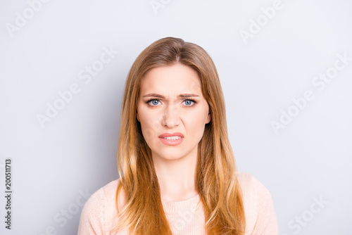 Valokuva  Close up portrait of funny confused puzzled unhappy upset sad uncertain unsure b