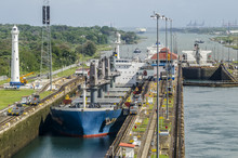 Oil Tanker Ship Entering The Miraflores Locks In The Panama Canal, Ships Are Raised Above Sea.