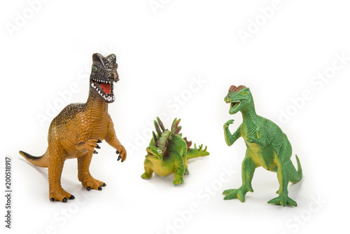 Dinosaur toy with open mouth on the white