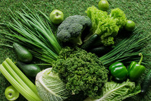 Top View Of Uncooked Tasty Green Vegetables On Grass, Healthy Eating Concept