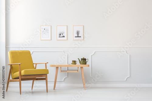 Obraz na plátně Yellow armchair in white interior