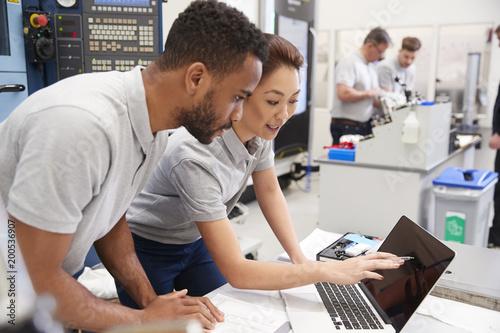 Fototapeta  Two Engineers Using CAD Programming Software On Laptop