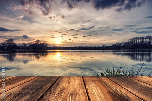 Keuken foto achterwand Meer / Vijver Stille am See - Steg Bei Sonnenuntergang