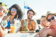 canvas print picture - Group of happy friends drinking tropical cocktails at boat party - Young people having fun in caribbean sea tour eating pineapple and laughing - Youth and summer vacation concept