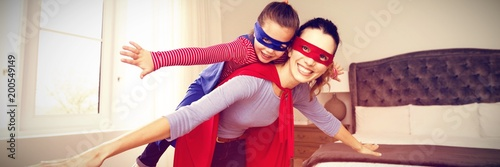 Mother and daughter playing superwoman Wallpaper Mural