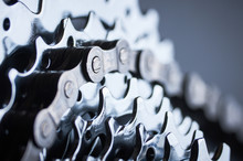 New Rear Mountain Bike Cassette With Chain On The Black Background Close Up