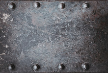 Metallic Background Painted With Multicolored Paint With Large Old Rivets