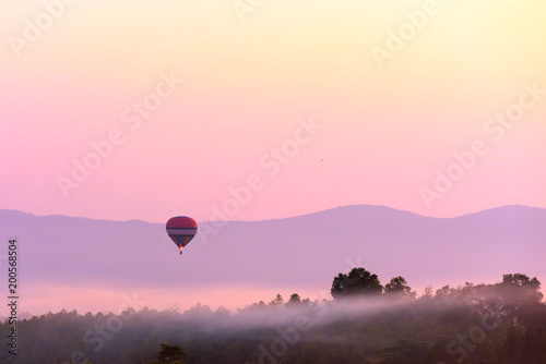 Foto op Canvas Luchtsport Colorful hot air balloon on sunrise .