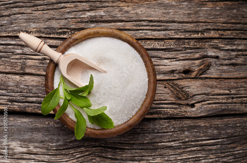 Stevia rebaudiana, sweet leaf sugar substitute in wooden bowl on wooden background