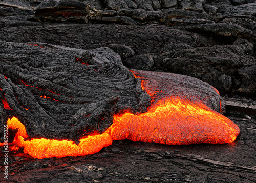 Poster Volcano Hot magma escapes from an earth column as part of an active lava flow, the glowing lava slowly cools and freezes - Location: Hawaii, Big Island, volcano
