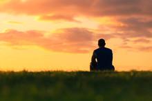 Man Sitting Alone Watching The...