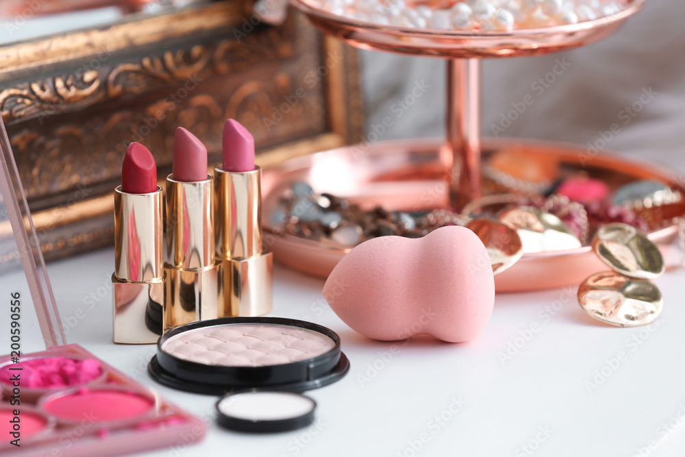 Fototapeta Decorative cosmetics on dressing table in makeup room