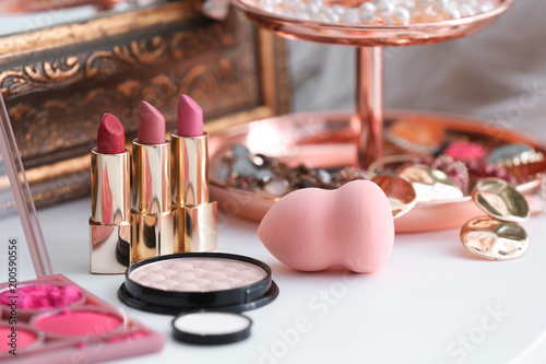 Decorative cosmetics on dressing table in makeup room