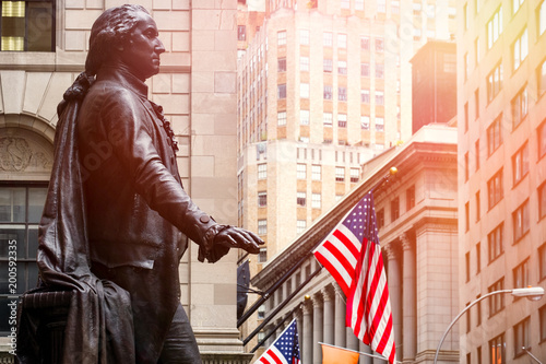Photo Stands New York City Wall Street in New York City at sunset with the statue of George Washington at the Federal Hall