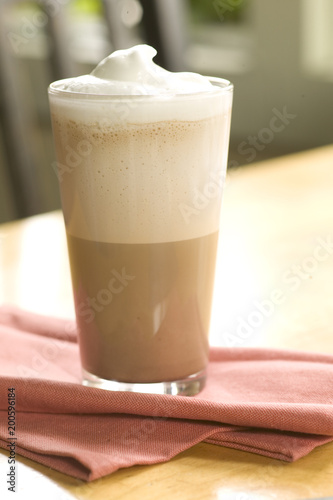 Tuinposter Milkshake cold coffee drink with foam