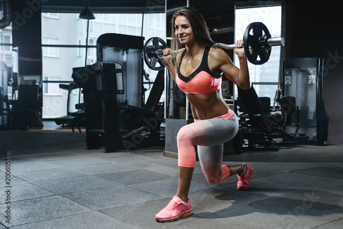 Foto op Plexiglas Fitness strong sexy athletic young girl working out in gym