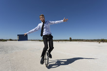 A Young Business Man Riding A ...