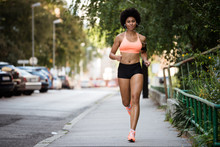 Full Length Portrait Of A Fit Woman Runner