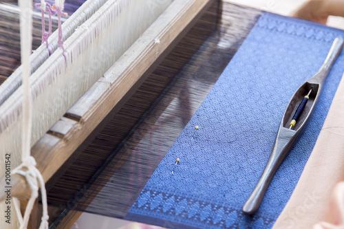 Fotografie, Obraz  silk string to make homemade textile Thai pattern style with weaving machine