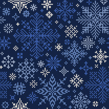 Seamless Knitted Pattern Of Blue And White Snowflakes