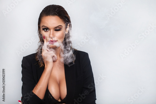 Fotografia, Obraz  Studio portrait of smoking girl