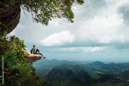 Hiker rest on a cliff,woman enjoy landscape of nature