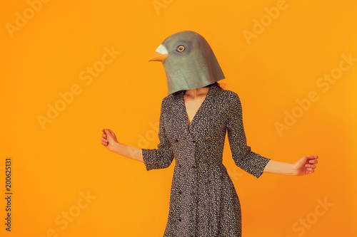 Woman portrait wearing pigeon mask and floral dress Canvas Print