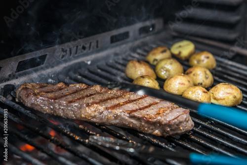Steak New York Being Prepared in Josper