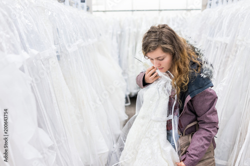 Young Woman Trying On Wedding Dress In Boutique Discount