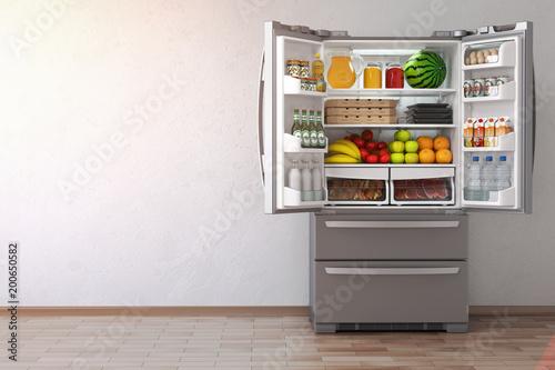 Fotografía  Open fridge  refrigerator full of food in the empty kitchen interior