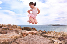 Little Girl Jumping In A Rocks...