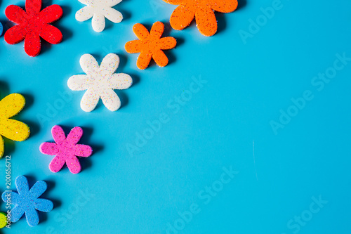 Valokuvatapetti Flower eva foam for decoration isolated on blue background, Foamiran is a decorative foamy material for creating artificial handmade flowers, View from above