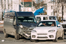Collision Of Two Cars. Crashed Minibus And Luxury Crossover SUV Cars
