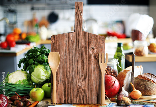Foto op Plexiglas Koken Kitchen a large wood board with vegetables and bread
