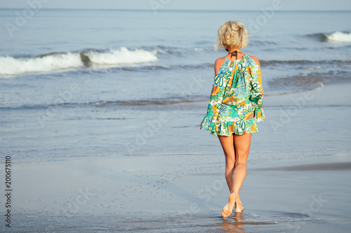 Deurstickers Boho Stijl girl looks at the sea view from the back