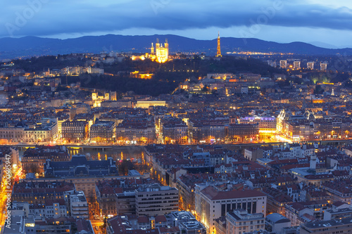 Wall Murals Kiev Aerial view of Old town with Fourviere cathedral during evening blue hour in Lyon, France