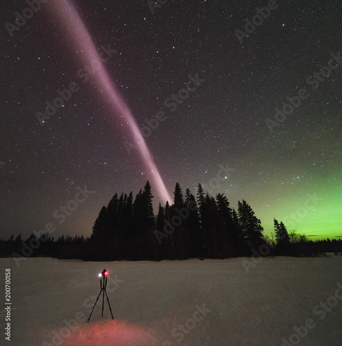 Fototapeta The Northern Lights and atmospheric phenomenon 'STEVE' which appears as a purple and green light ribbon in the sky