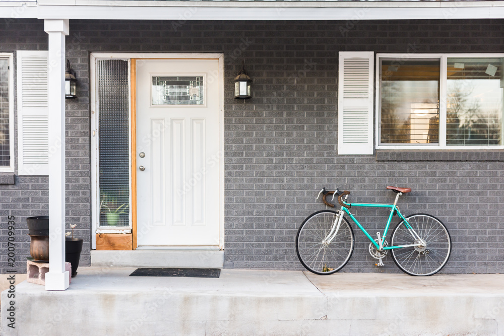 Fototapeta Turquoise bicycle or bike on front porch