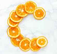 Orange Slices Vitamin C Letter On White Background
