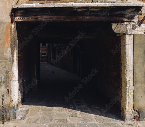 Dark and mysterious alleyway in Venice's Jewish Ghetto. Canvas Print