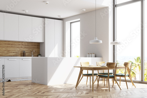 Deurstickers Nieuw Zeeland White and wooden kitchen with a table, side view