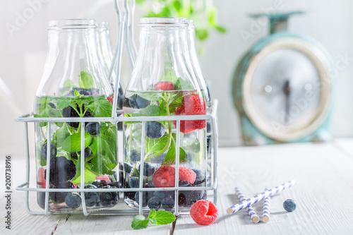 Staande foto Vlees Closeup of healthy water in bottle with berries