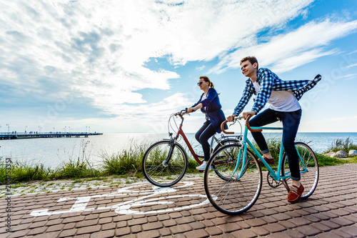 Healthy lifestyle - people riding bicycles Fototapeta